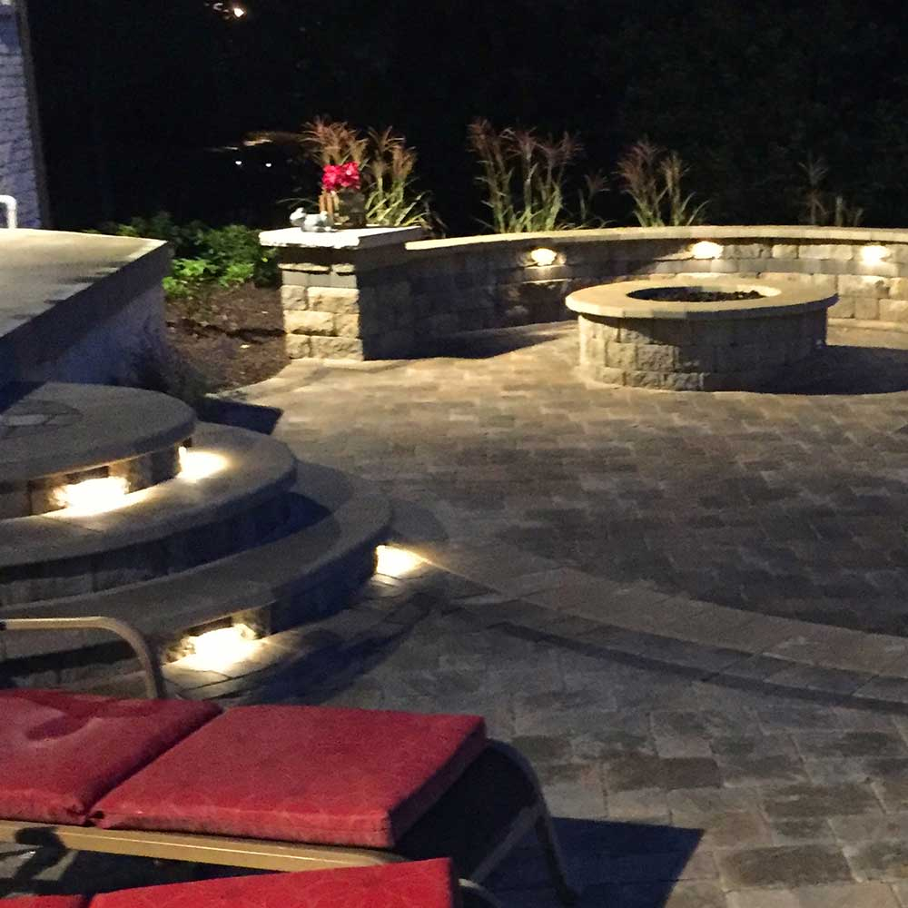 custom outdoor lighting on the steps of outdoor patio
