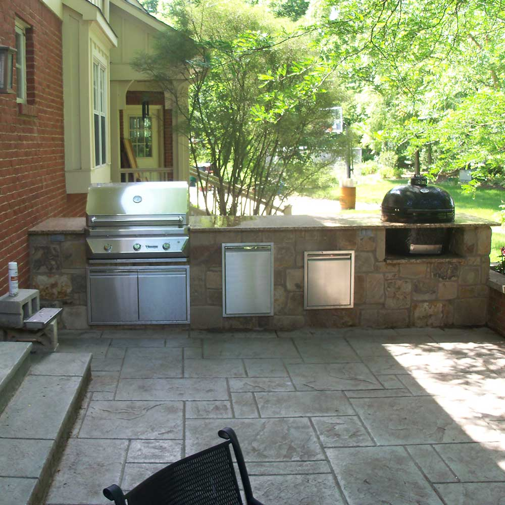 outdoor kitchen design with built in grill, smoker, trash drawer, and storage